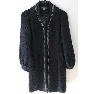 Alexander McQueen black coat with long chains